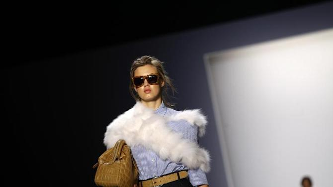 A model presents a creation from the Michael Kors Spring/Summer 2014 collection during New York Fashion Week