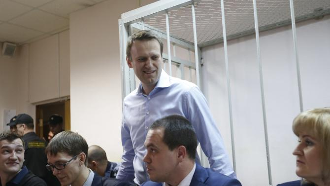 Russian opposition leader and anti-corruption blogger Navalny arrives at a court hearing in Moscow