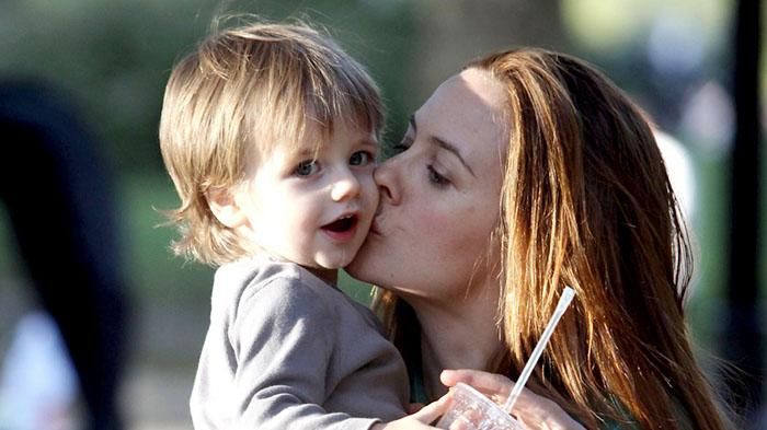Alicia Silverstone carries her son Bear Blue in between takes of filming new movie 'Gods Behaving Badly' in Central Park, New York City