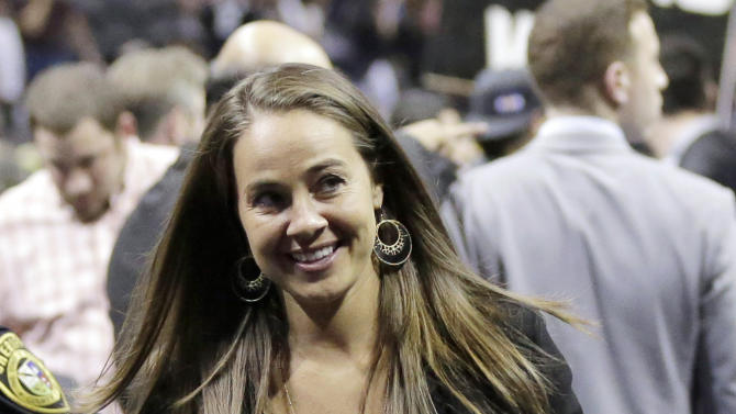 FILE - In this April 30, 2014, file photo, San Antonio Stars' Becky Hammon walks off the court following Game 5 of the opening-round NBA basketball playoff series between the San Antonio Spurs and the Dallas Mavericks in San Antonio. The Spurs have hired Hammon as an assistant coach, making her the first woman to join an NBA coaching staff. The Spurs made the announcement Tuesday, Aug. 5, 2014. Hammon plans to retire from the San Antonio Silver Stars after this season. (AP Photo/Eric Gay, File)