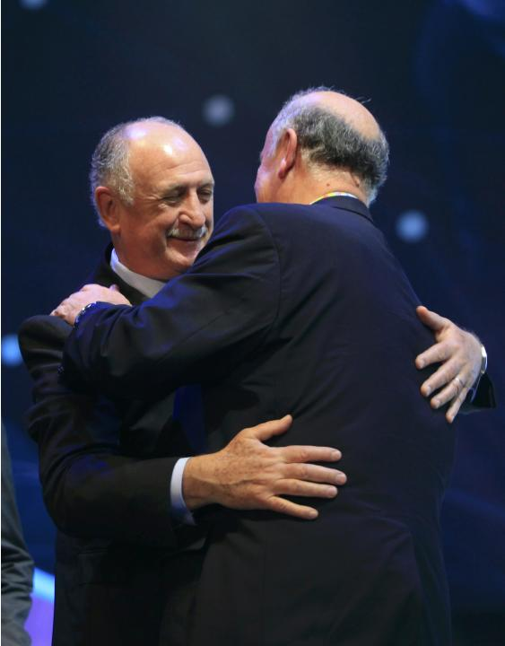 Bosque hugs Scolari during the draw for the 2014 World Cup in Sao Joao da Mata