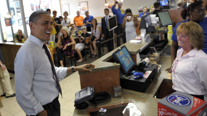President Barack Obama orders lunch on a stop at Skyline Chili in Cincinnati, Monday, July 16, 2012. Obama is spending the day campaigning in Cincinnati. (AP Photo/Susan Walsh)