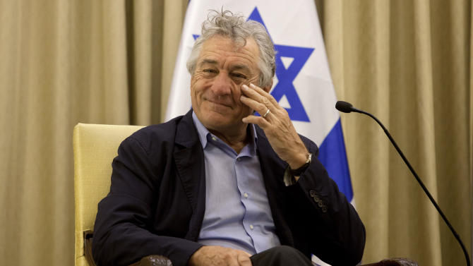 U.S. actor Robert De Niro gestures prior to his meeting with Israel's President Shimon Peres at the President's residence in Jerusalem Tuesday, June 18, 2013. (AP Photo/Sebastian Scheiner)