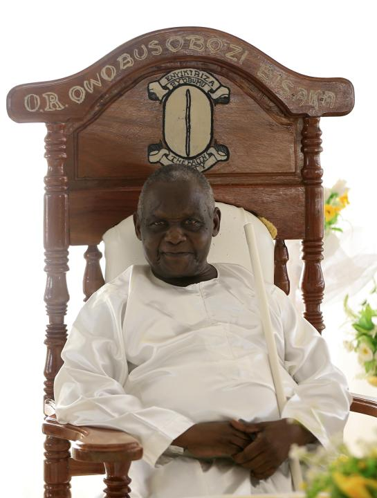 Omukama Ruhanga Owobusobozi Bisaka, an 83-year-old self-professed god and founder of the Ugandan cult group Faith of Unity, is photographed on his throne at the cult's headquarters in Kapyemi village