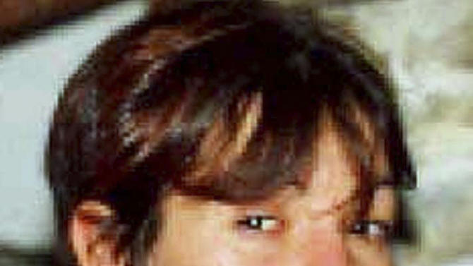 FILE - This file photo released by the Italian police on Oct. 18, 2010, shows Lea Garofalo in an unknown location. Garofalo, a woman who dared to cooperate with police in the fight against a dreaded Italian mob network was murdered, her body dumped in a barrel of acid in the countryside near Milan. Her 17-year-old daughter stepped forward and testified, helping to send six people to prison for life. (AP Photo/Italian Police, File)