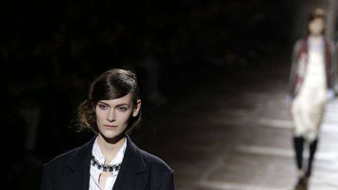 A model presents a creation for Belgian fashion designer Dries van Noten's Ready to Wear's Fall-Winter 2013-2014 fashion collection, presented, Wednesday Feb.27, 2013 in Paris. (AP Photo/Christophe Ena)