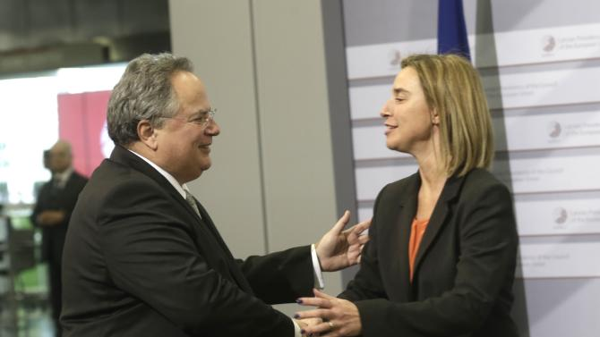 European Union Foreign Policy Chief Mogherini greets Greek Minister of Foreign Affairs Kotzias during informal European Union Ministers of Foreign Affairs meeting in Riga
