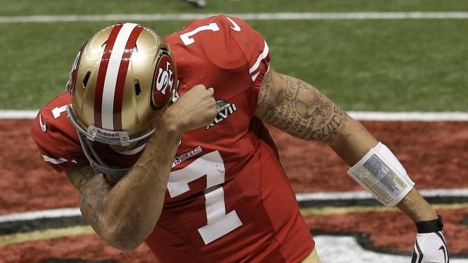 San Francisco 49ers quarterback Colin Kaepernick (7) celebrates after running for a 15-yard touchdown against the Baltimore Ravens during the second half of the NFL Super Bowl XLVII football game, Sunday, Feb. 3, 2013, in New Orleans. (AP Photo/Elaine Thompson)
