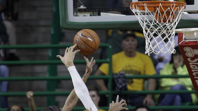 Oklahoma's Nicole Griffin (4) is fouled by Baylor's Brittney Griner (42) during the second half of an NCAA college basketball game Saturday, Jan. 26, 2013, in Waco Texas.  Baylor won 82-65. (AP Photo/LM Otero)
