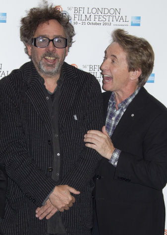 "Director Tim Burton and actor Martin Short react during a photocall for Burton's ""Frankenweenie"" during the London Film Festival at The Odeon, Leicester Square on Wednesday, October 10, 2012 in London. (Photo by Joel Ryan/Invision/AP)"