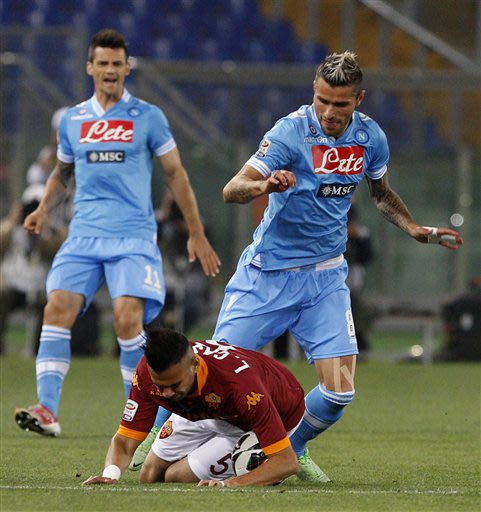 AS Roma defender Leandro Castan, of Brazil, bottom, is challenged by Napoli midfielder Valon Behrami, of Switzerland, during a Serie A soccer match between AS Roma and Napoli, at Rome's Olympic stadiu