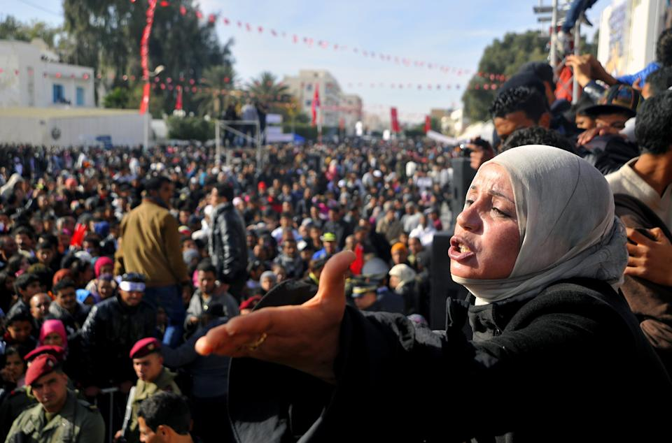 A woman gesticulates during a protest against the visit of Tunisian President Moncef Marzouki, Monday, Dec. 17, 2012, in Sidi Bouzid, south Tunisia, the birthplace of the country's recent revolution. Marzouki arrived to mark the revolution's second anniversary. (AP Photo/Hichem Borni)
