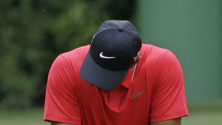 Tiger Woods reacts after missing a putt on the fourth green during the fourth round of the Masters golf tournament Sunday, April 14, 2013, in Augusta, Ga. (AP Photo/Darron Cummings)