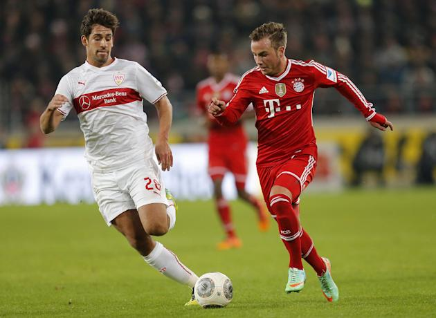 Stuttgart's Rani Khedira, left, and Bayern's Mario Goetze challenge for the ball during a German first soccer division Bundesliga match between VfB Stuttgart and FC Bayern Munich in Stuttgart,