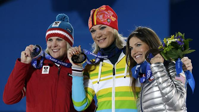 Women's super combined medalists, from left, Nicole Hosp of Austria, silver, Maria Hoefl-Riesch of Germany, gold, and Julia Mancuso of the United States, bronze, pose with their medals at the 2014 Winter Olympics in Sochi, Russia, Monday, Feb. 10, 2014. (AP Photo/Morry Gash)