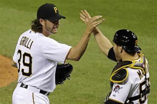 Pittsburgh Pirates closer Jason Grilli, left, celebrates with catcher Russell Martin after getting the final out of a 5-4 win over the Chicago Cubs in a baseball game in Pittsburgh Tuesday, May 21, 20