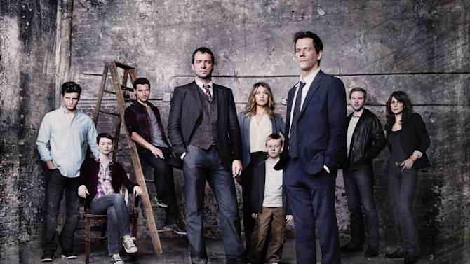 "This undated publicity photo released by FOX shows Kevin Bacon, front right, as former FBI agent Ryan Hardy, who is called out of retirement to track down James Purefoy, (fourth from left) as Joe Carroll, in the new psychological thriller ""The Following,"" premiering Monday, Jan. 21, 2013,  (9:00-10:00 PM ET/PT) on FOX.  From rear left, cast members, Nico Tortorella, Valorie Curry, Adan Canto, Natalie Zea, Kyle Catlett, Shawn Ashmore and Annie Parisse. Fox's entertainment chief, Kevin Reilly, said Tuesday, Jan. 8, 2013, that the network did not change the content or promotion of ""The Following,"" its upcoming drama about a serial killer, because of the Connecticut school shooting or other real-life acts of violence. (AP Photo/FOX, Michael Lavine)"