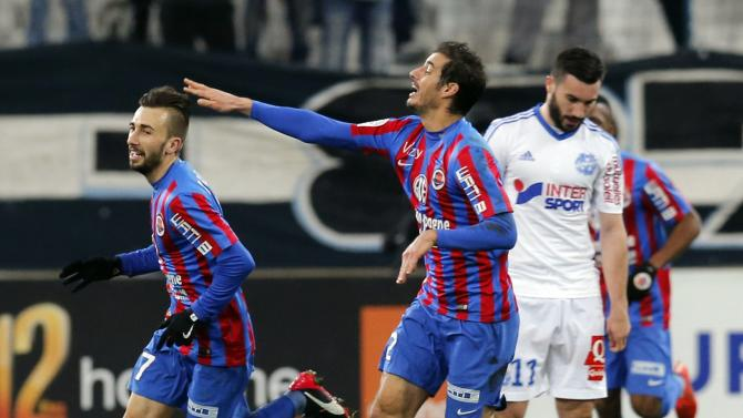 Caen's Benezet celebrates after scoring against Olympique Marseille during their French Ligue 1 soccer match at the Velodrome stadium in Marseille