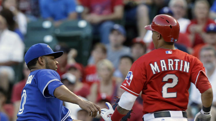 Texas Rangers' Leonys Martin (2) is tagged out by Toronto Blue Jays first baseman Edwin Encarnacion, left, while running to first base after bunting during the third inning of a baseball game on Thursday, June 13, 2013, in Arlington, Texas. (AP Photo/LM Otero)