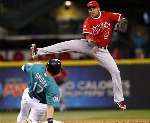 Morales, Hunter help Angels end Mariners' streak