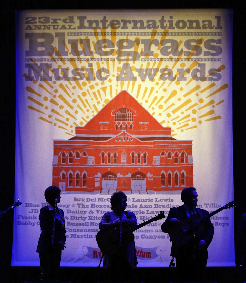 Dale Ann Bradley, center, and her band wait to be introduced for their performance at the International Bluegrass Music Association Awards show on Thursday, Sept. 27, 2012, in Nashville, Tenn. (AP Photo/Mark Humphrey)
