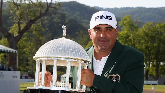 Angel Cabrera of Argentina holds the trophy after winning the Greenbrier Classic at the Old White TPC on July 6, 2014 in White Sulphur Springs, West Virginia