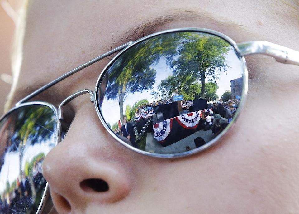President Barack Obama is reflected in Megan Malin's, 14, sunglasses during a campaign event at Morningside College, Saturday, Sept. 1, 2012, in Sioux City, Iowa. (AP Photo/Pablo Martinez Monsivais)