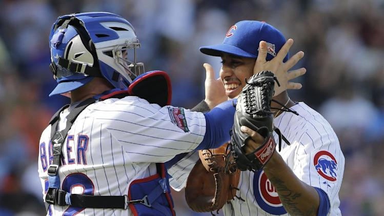 Chicago Cubs relief pitcher Hector Rondon, right, celebrates with catcher John Baker after the Cubs defeated the Baltimore Orioles 4-1 in an interleague baseball game in Chicago, Friday, Aug. 22, 2014. (AP Photo/Nam Y. Huh)