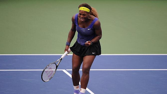 Serena Williams reacts during a match against Caroline Wozniacki of Denmark on day 8 of the Western & Southern Open at the Linder Family Tennis Center on August 16, 2014 in Cincinnati, Ohio