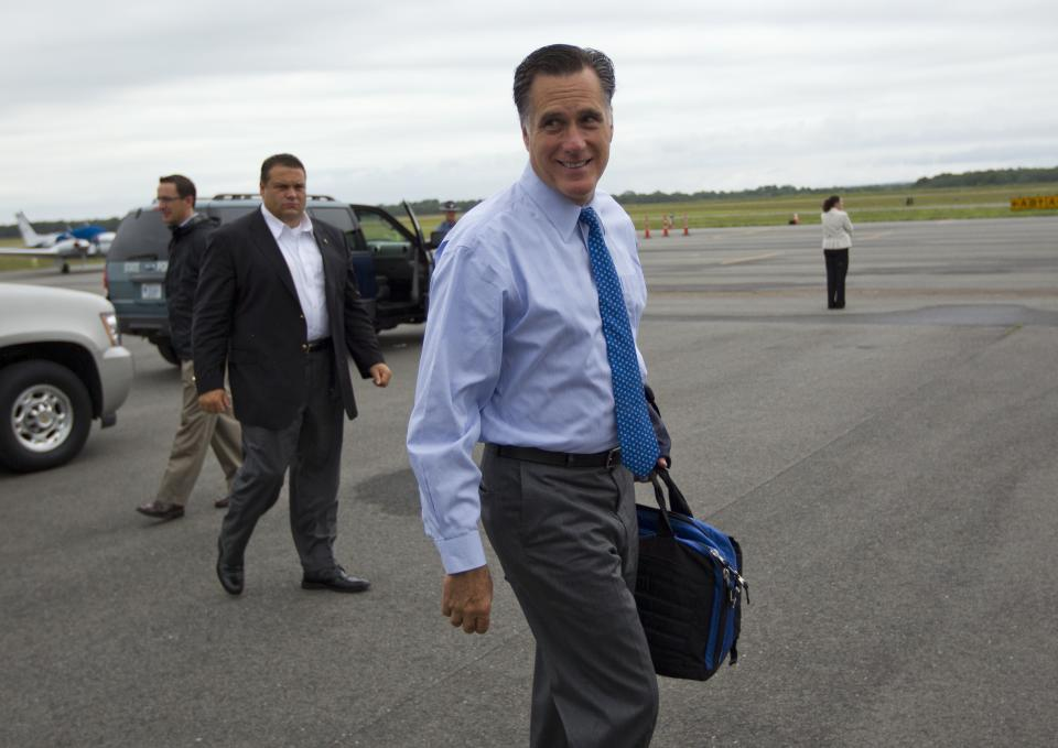 Republican presidential candidate, former Massachusetts Gov. Mitt Romney walks to board his flight at Martha's Vineyard airport for fundraising events on Saturday, Aug. 18, 2012 in West Tisbury, Mass. (AP Photo/Evan Vucci)