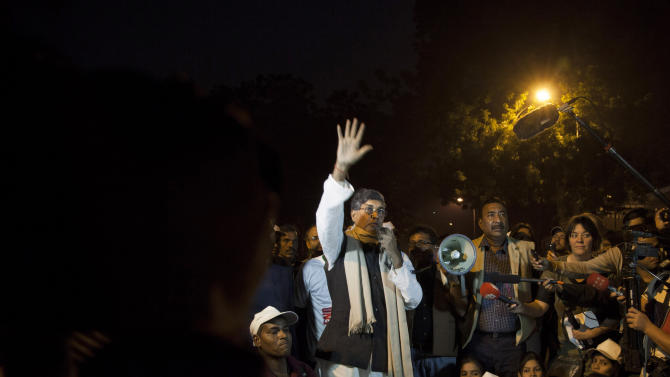 Indian children's rights activist Kailash Satyarthi raises his hand and speaks during a candlelit vigil in New Delhi, India, Saturday, Nov. 22, 2014. Satyarthi and Malala Yousafzai of Pakistan jointly won the Nobel Peace Prize for 2014, for risking their lives to fight for children's rights. (AP Photo/Tsering Topgyal)