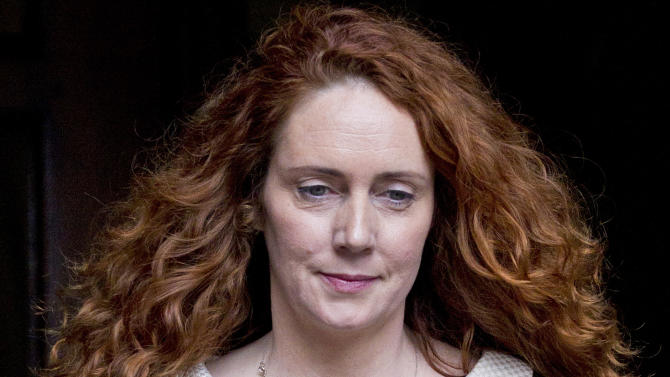 FILE This Friday, May 11, 2012 file photo shows Rebekah Brooks, former chief executive of News International leaves the High Court in London after giving evidence to the Leveson Inquiry. Brooks said Tuesday May 15, 2012 she and her husband will face charges over Britain's tabloid phone hacking scandal. Brooks, 43, said Tuesday in a statement that she will be prosecuted over allegations of obstruction of justice.(AP Photo/Sang Tan)