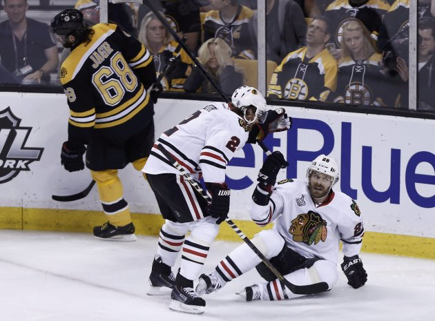 Blackhawks' Handzus celebrates his goal with teammate Keith as Bruins' Jagr skates away during the first period in Game 4 of their NHL Stanley Cup Finals hockey series in Boston