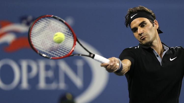 Roger Federer, of Switzerland, returns to Roberto Bautista Agut, of Spain, during the fourth round of the U.S. Open tennis tournament, Tuesday, Sept. 2, 2014, in New York. (AP Photo/Charles Krupa)