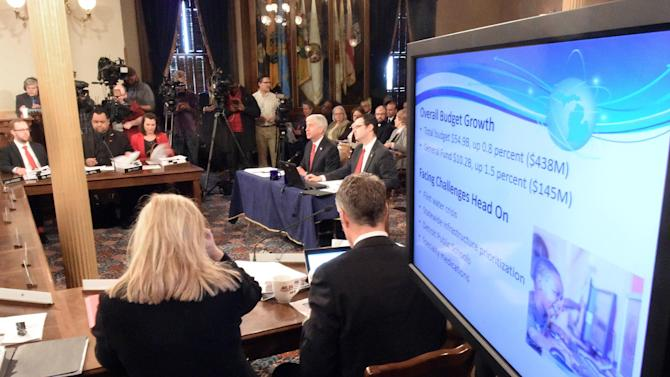 Governor Rick Snyder presents the budget to the combined House and Senate Appropriations committees in the Capitol in Lansing, Mich., on Wednesday, Feb 10, 2016.  The budget contains special funding for Flint's water problems and Detroit Public Schools. (Dale G. Young/The Detroit News via AP)