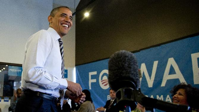 President Barack Obama speaks to media as he visits a campaign office the morning of the 2012 election, Tuesday, Nov. 6, 2012, in Chicago. (AP Photo/Carolyn Kaster)