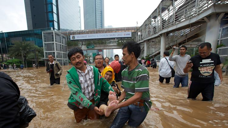 Jakarta Floods Displace Thousands