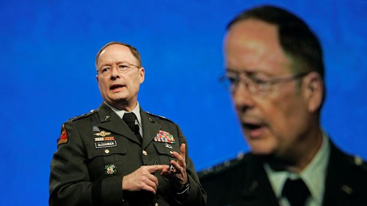 FILE - In this April 21, 2009, photo, then-Lt. General Keith Alexander, who was then-director of the National Security Agency, speaks at the RSA Conference in San Francisco. Without warning, the electricity goes out, leaving you and your family in the dark for days, perhaps weeks. Or the gates of a dam holding back millions of gallons of water open suddenly and flood towns below. Or pipes in a chemical plant rupture, releasing deadly gas. Any one, or all, of these nightmare scenarios could be invisibly set in motion by hackers, terrorist groups or foreign governments with the motivation and technical know-how. Alexander, head of U.S. Cyber Command, has rated the country's preparedness for a major cyberattack as poor, a 3 on a scale of 1 to 10. (AP Photo/Jeff Chiu)