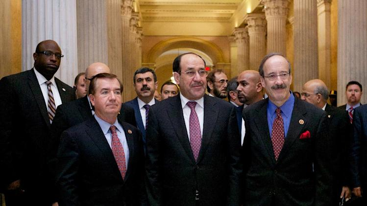 "Iraqi Prime Minister Nouri al-Maliki, center, walks with the House Foreign Affairs Committee ranking Democrat Rep. Eliot Engel, D-N.Y., right, and the committee's chairman Rep. Ed Royce, R-Calif. in Washington, Wednesday, Oct. 30, 2013, before their meeting. Al-Maliki says terrorists ""got a second chance"" to thrive in Iraq, largely as the result of the rise of al-Qaida fighters in neighboring Syria's civil war. (AP Photo/Molly Riley)"