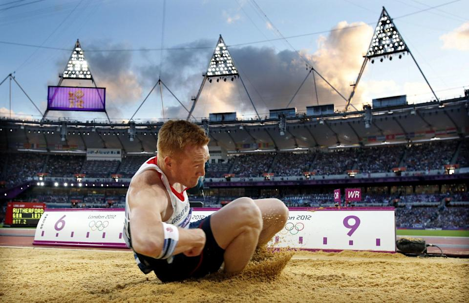 Gold medal winner, Britain's Greg Rutherford, competes in the men's long jump during athletics competition in the Olympic Stadium at the 2012 Summer Olympics, Saturday, Aug. 4, 2012, in London. (AP Photo/Matt Dunham)