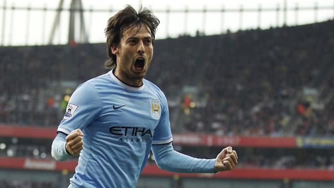 Manchester City's Spanish midfielder David Silva celebrates scoring a goal against Arsenal on March 29, 2014 at the Emirates Stadium in London