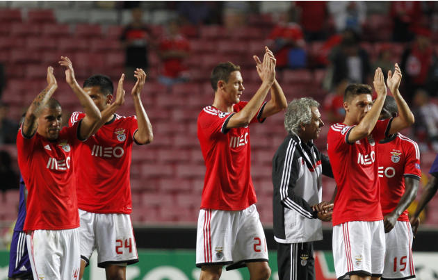 Benfica's players celebrate at the end of the Champions League group C soccer match between Benfica and Anderlecht Tuesday, Sept. 17, 2013, at Benfica's Luz stadium in Lisbon