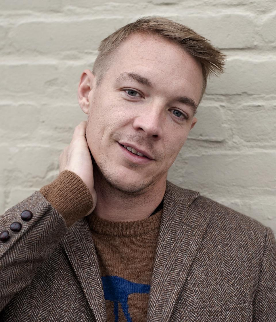 FILE - In a Feb. 7, 2013 file photo, DJ and music producer Diplo poses for a portrait at the Mad Decent Studios, in Los Angeles. Diplo is performing with his group Major Lazer at the Ultra Music Festival in Miami, which begins Friday, March 15, 2013. (Photo by Dan Steinberg/Invision/AP)