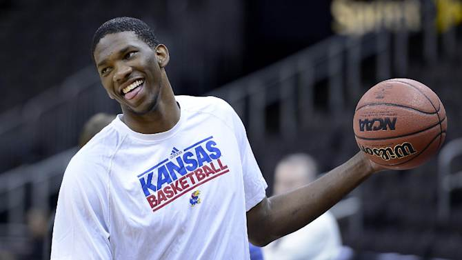 KU's Joel Embiid, who will sit our the Big 12 Tournament because of a back injury, did join the team for a brief shoot-around Wednesday, March 12, 2014 at the Sprint Center in Kansas City. (AP Photo/The Kansas City Star, Rich Sugg)