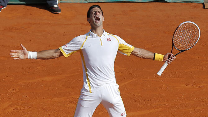 Novak Djokovic of Serbia reacts after defeating Spain's Rafael Nadal in their final match of the Monte Carlo Tennis Masters tournament in Monaco, Sunday, April 21, 2013. (AP Photo/Lionel Cironneau)