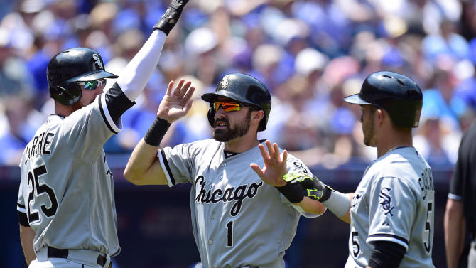 Chicago White Sox Adam Eaton (1) and Carlos Sanchez (5) celebrate with teammate Adam LaRoche (25) after scoring in the third inning of a baseball game against the Toronto Blue Jays in Toronto, Wednesday, May 27, 2015.(Frank Gunn/The Canadian Press via AP) MANDATORY CREDIT
