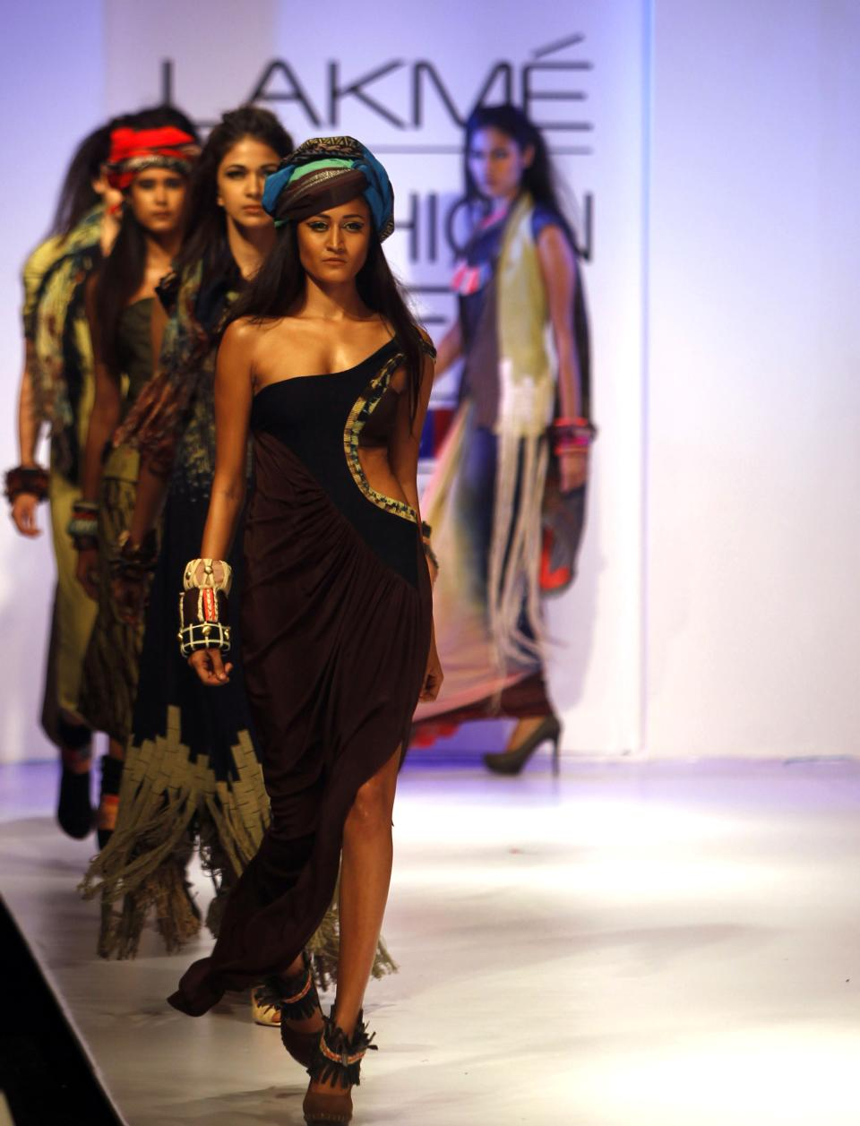 Indian models display creations by Babita M. during the Lakme Fashion Week in Mumbai, India, Saturday, Aug. 4, 2012. (AP Photo/Rafiq Maqbool)