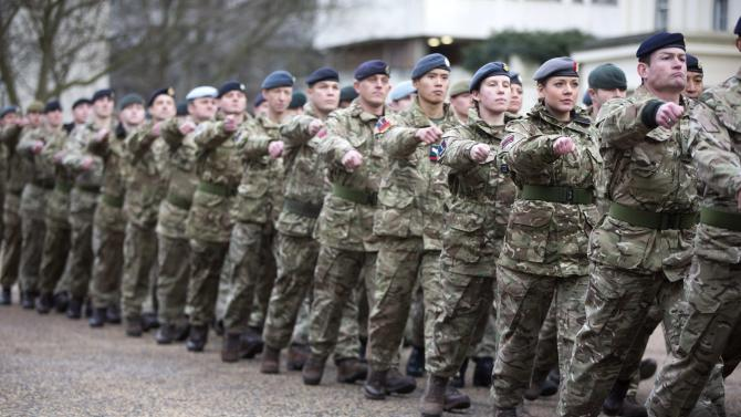 "Members of Britain's armed forces march from Wellington Barracks to The Houses of Parliament during the final ""March Into Parliament"" for Operation Herrick in London"