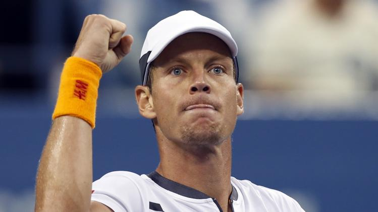 Berdych of the Czech Republic celebrates defeating Klizan of Slovakia following their five set match at the 2014 U.S. Open tennis tournament in New York