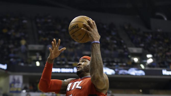 Atlanta Hawks' Josh Smith (5) goes in for a dunk against Indiana Pacers' Ian Mahinmi (28) during the first half of Game 5 in the first round of the NBA basketball playoff series on Wednesday, May 1, 2013, in Indianapolis. (AP Photo/Darron Cummings)